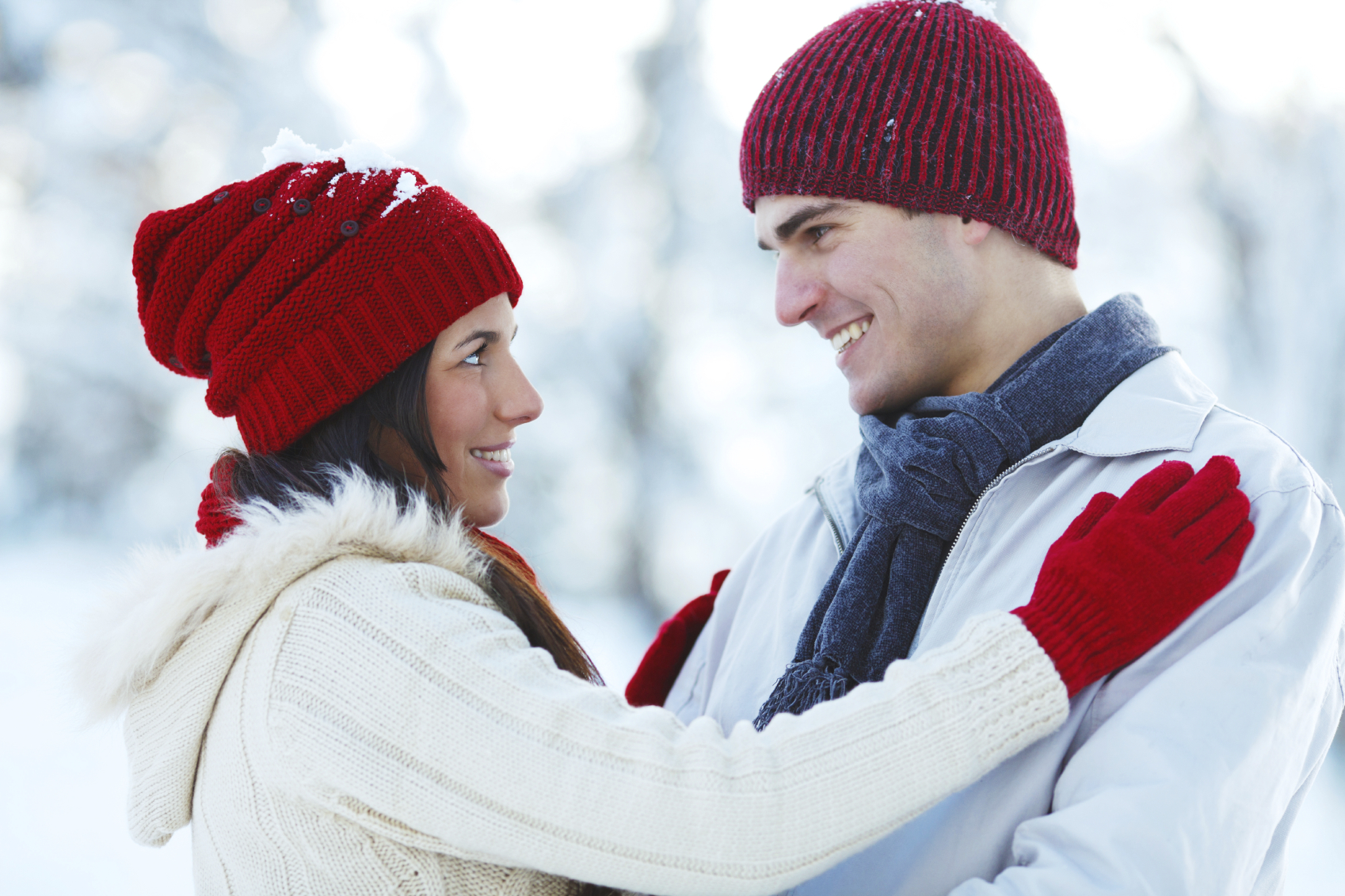 Close-up of a young couple wearing knit hats.