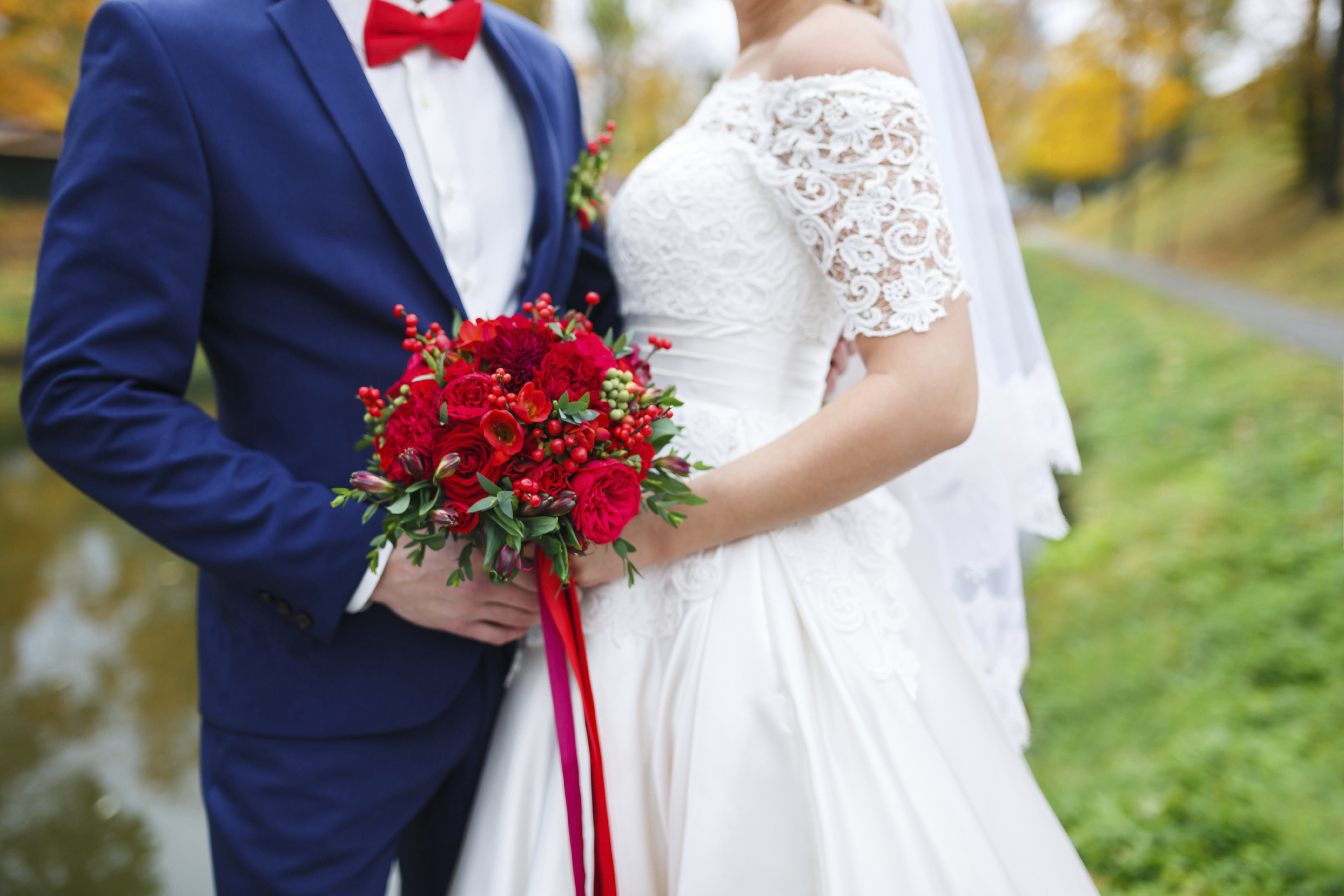 Couple with red bouquet