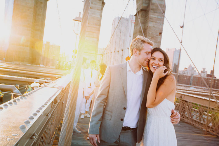 Young-couple-on-Brooklyn-Bridge-at-sunset-000077884509_Medium