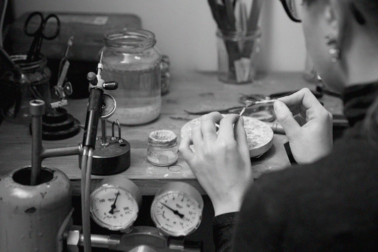 Young-female-jeweller-working-on-a-new-design-000054414484_Large-(1).jpg