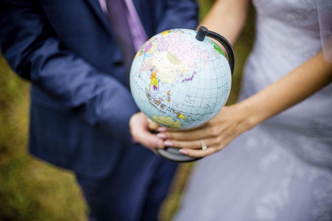 Bride-and-groom-holding-globe-000036664118_Large