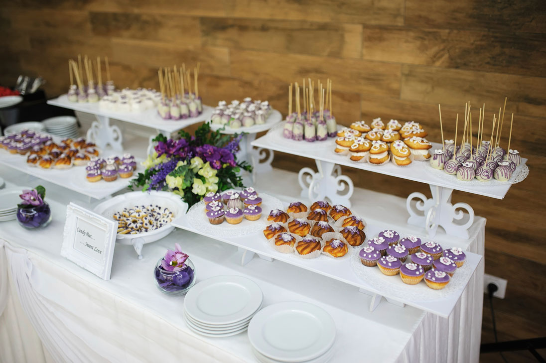wedding-dessert-with-delicious-cakes-and-macaroons-000060170188_Large