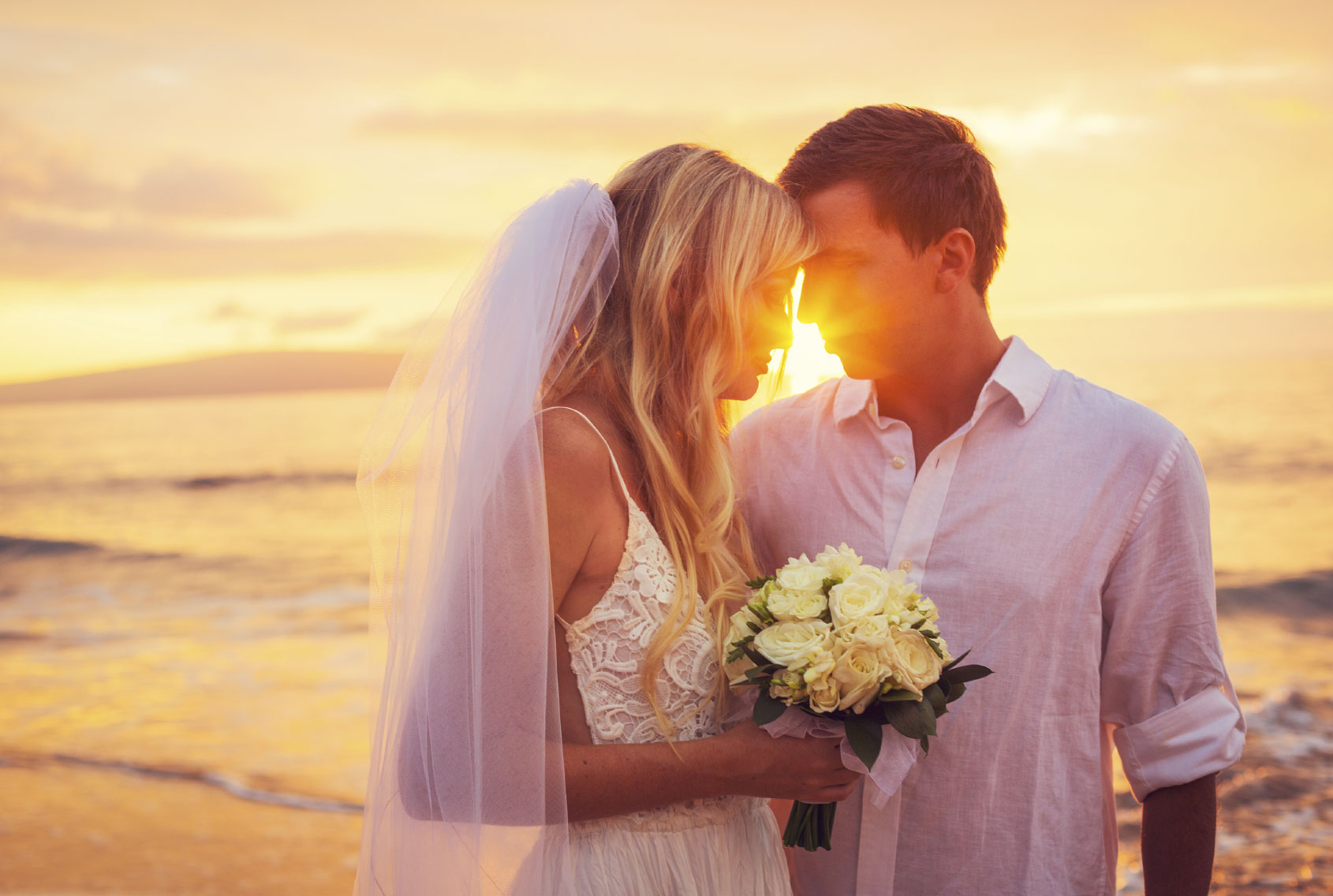 A-bride-and-groom-enjoying-the-view-and-the-amazing-sunset-000031865728_Medium.jpg