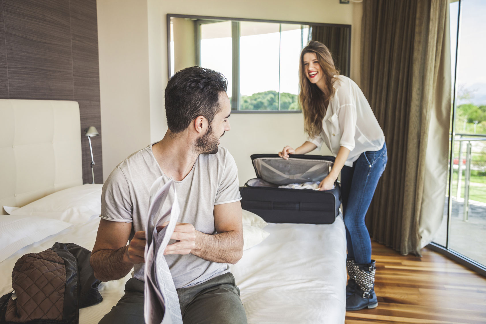 Couple-in-hotel-room-getting-dressed-000054796390_Medium.jpg