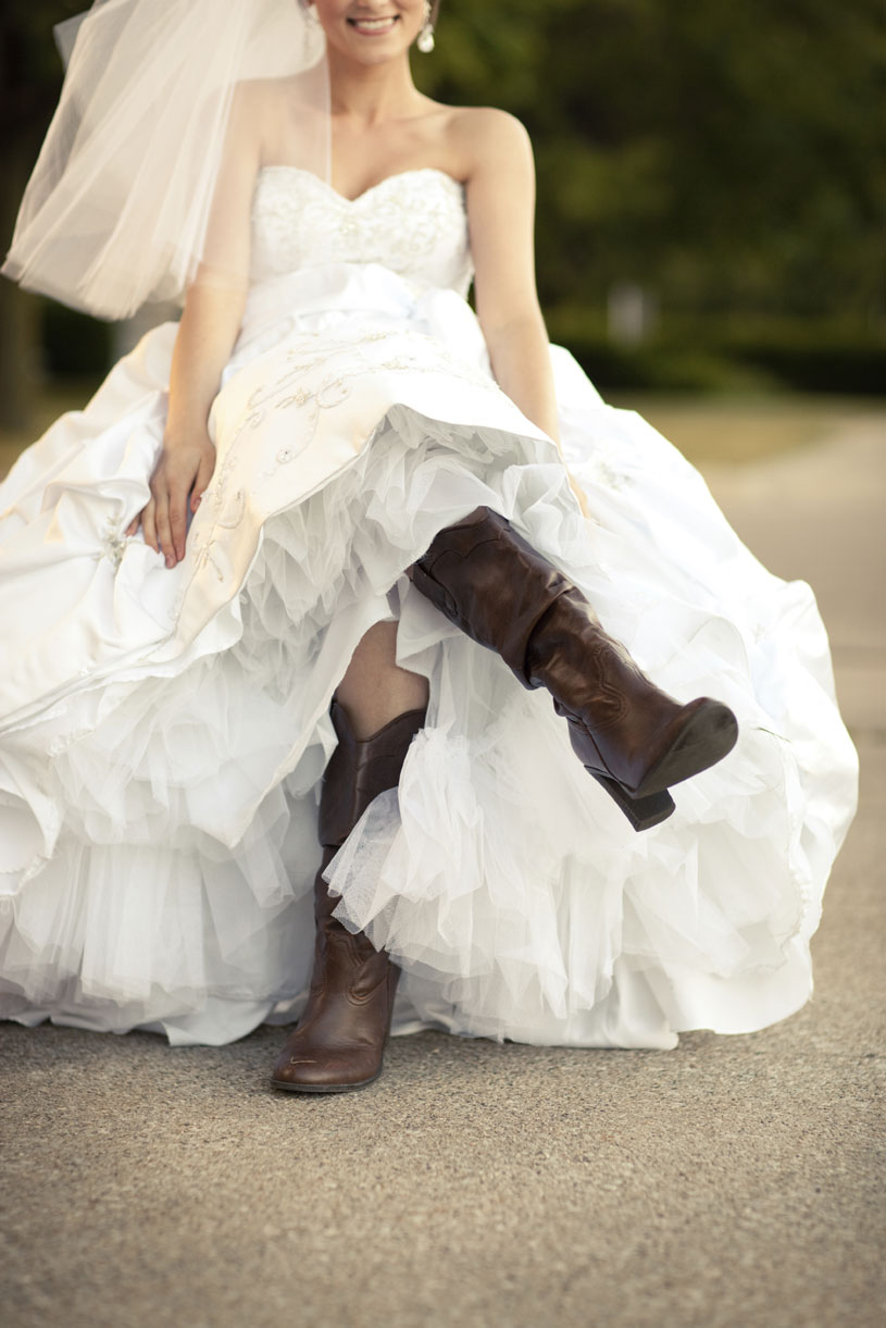 Happy-Bride-in-Wedding-Dress-and-Cowboy-Boots-000068887321_Large.jpg