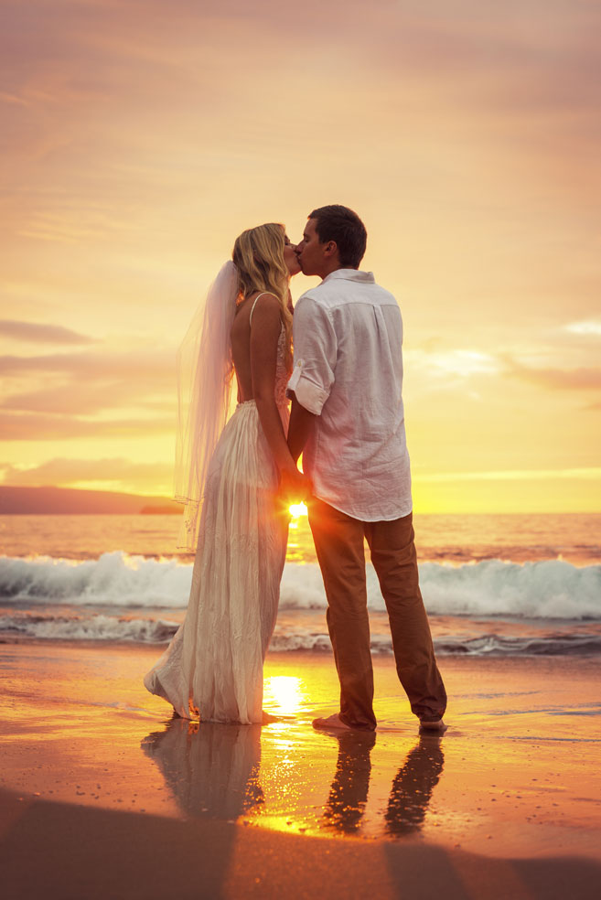Just-married-couple-kissing-on-tropical-beach-at-sunset-000032199840_Medium-(1).jpg