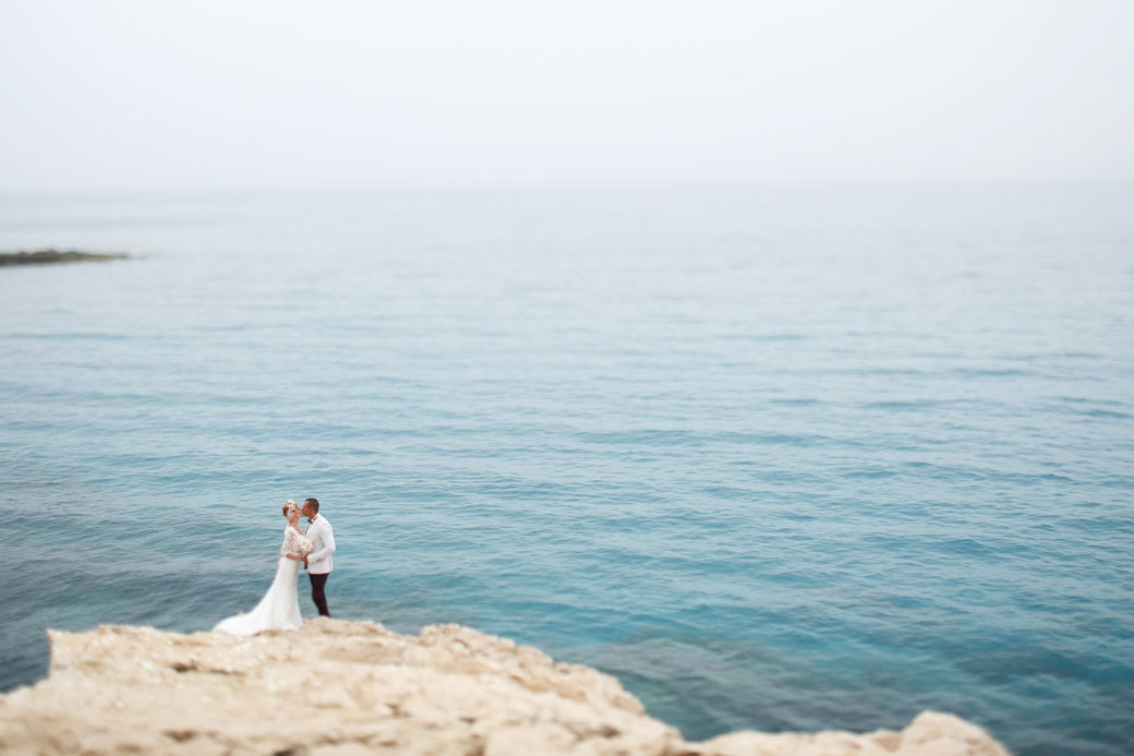 beautiful--gorgeous-blonde-bride--and-stylish-groom-on-rocks,-on-000089964755_Medium.jpg