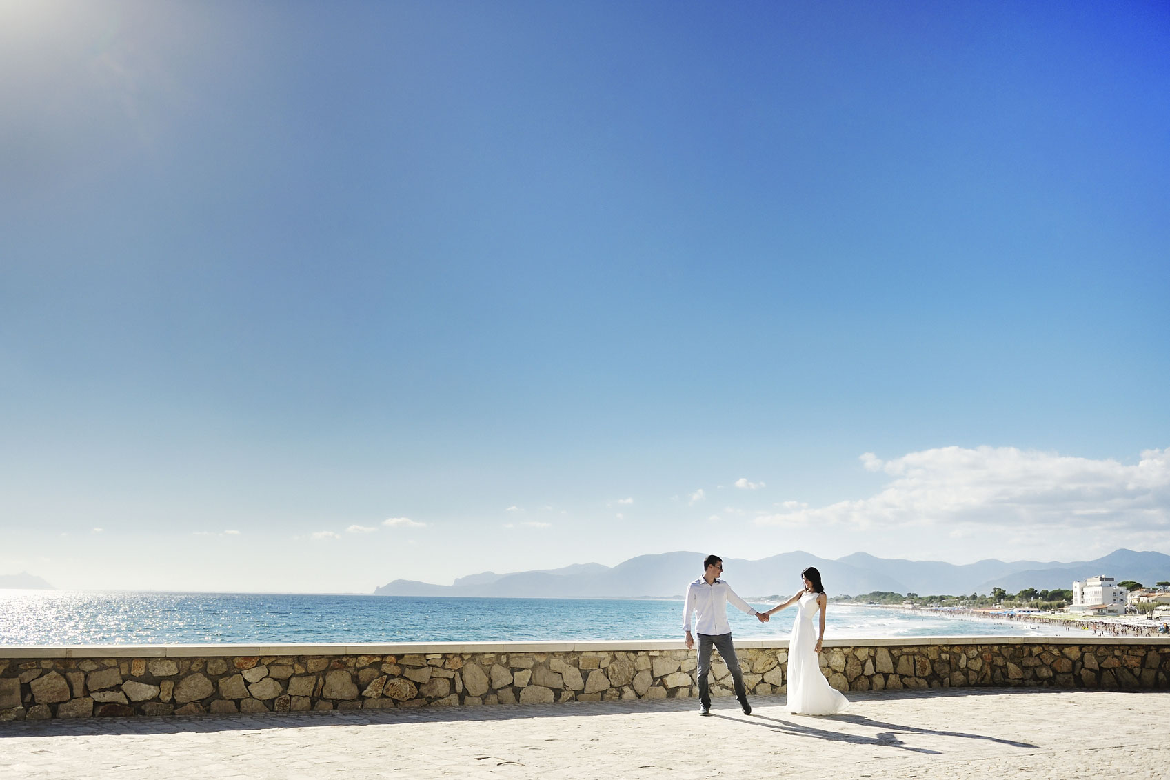 bride-and-groom-holding-hands-in-Sperlonga,-Italy-000084160067_Medium.jpg