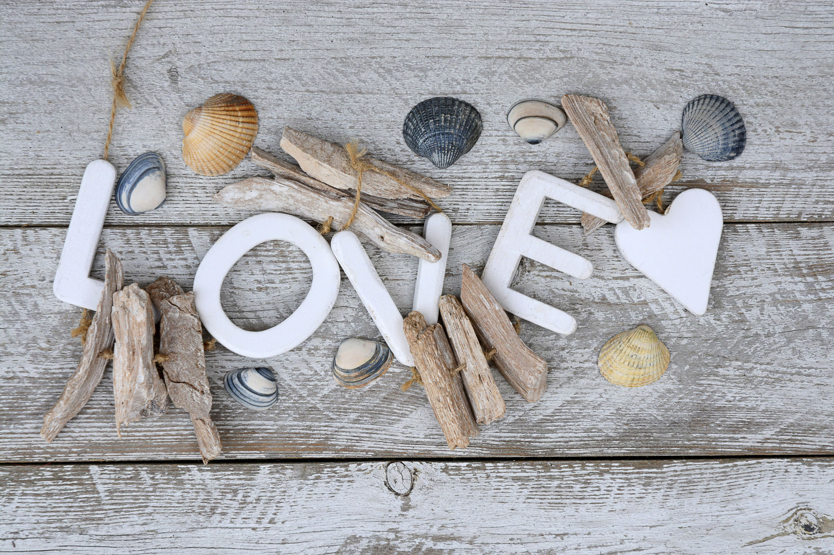 white-wooden-background-with-shells,-love-letters-and-heart-shape-000076745031_Medium.jpg