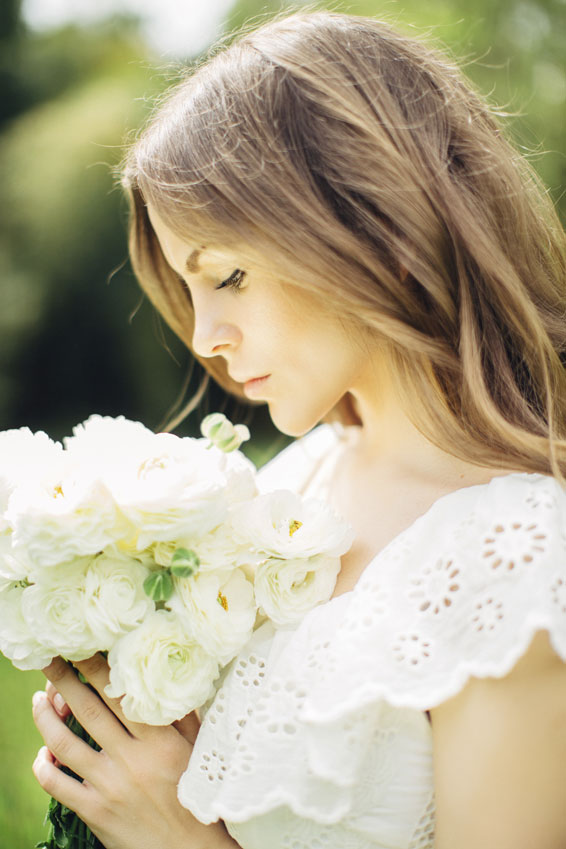 Beautiful-bride-on-a-background-of-summer-forest-000068142957_Medium