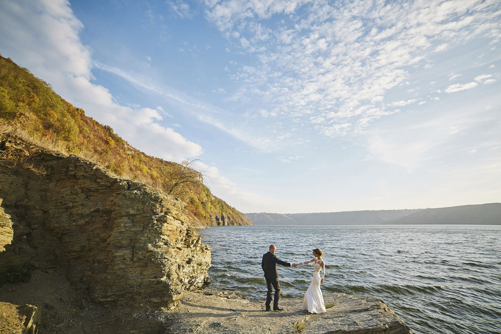 lovers-in-a-wedding-dress-near-the-sea-and-mountains-000091840689_Medium-(1).jpg