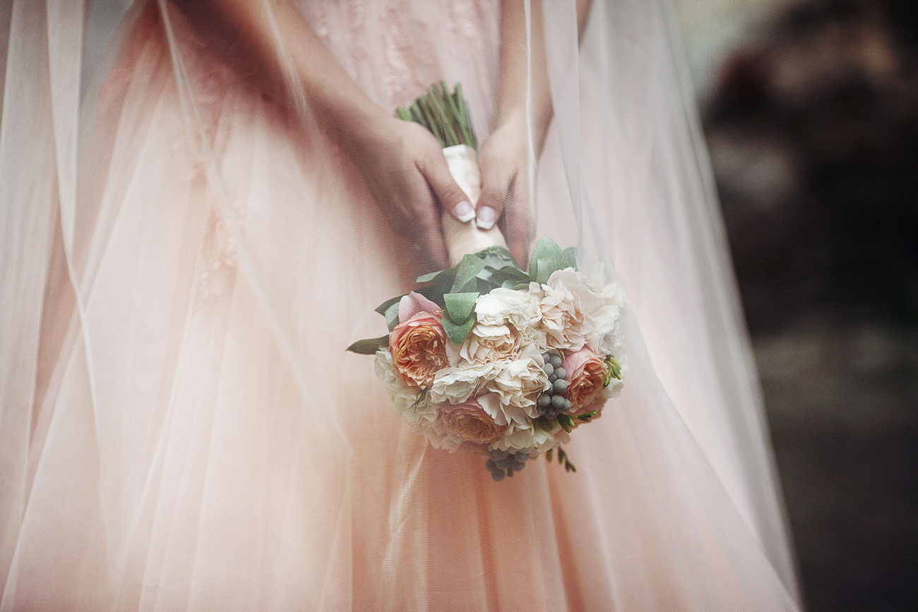Beautiful-bride-in-a-pink-dress-holding-a-bouquet-000083674295_Medium.jpg