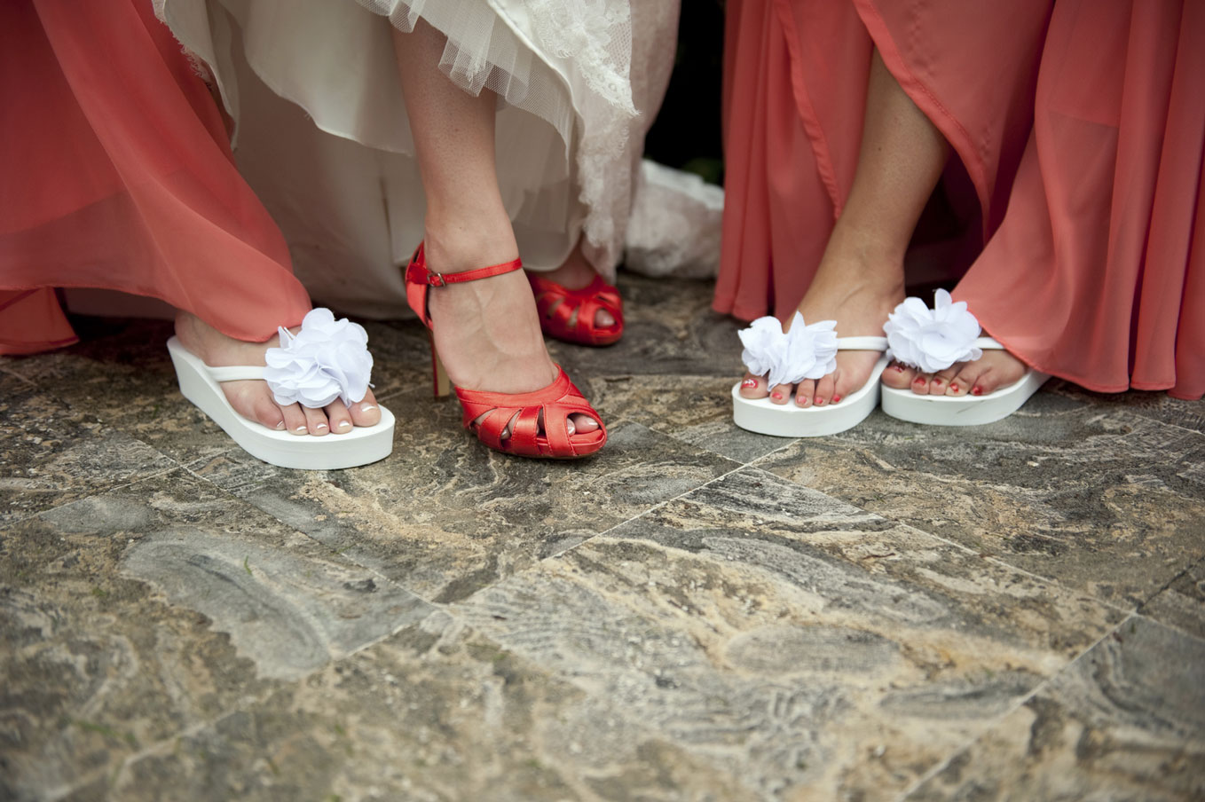 bride-and-bridesmaid-showing-off-shoes-000013697769_medium