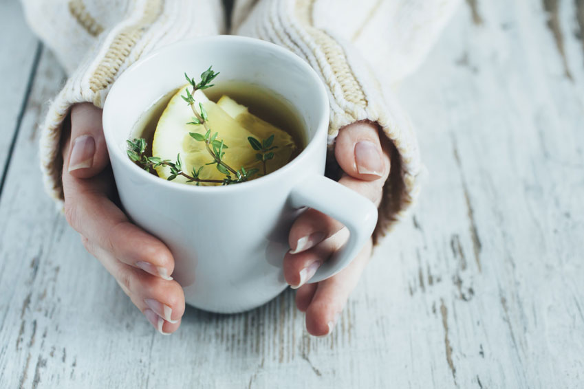 Cup-of-tea-with-thyme-herb-and-lemon-slices-000086928777_Medium.jpg