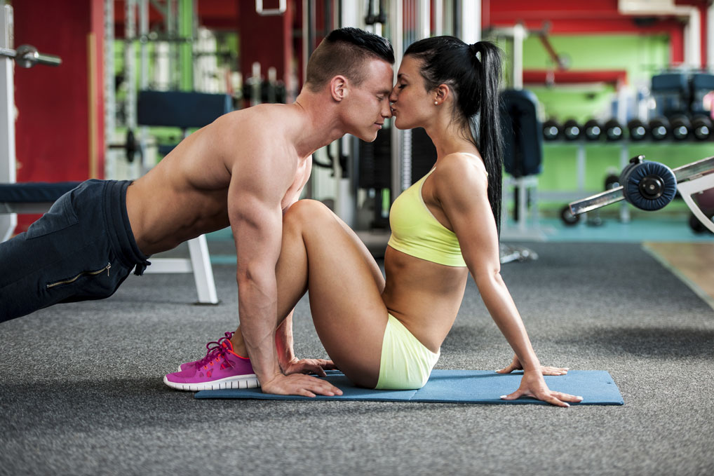 Fitness-couple-workout-fit-man-and-woman-train-in-gym-000084156527_Medium.jpg