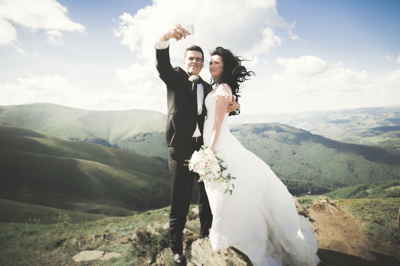 Just-married-couple-on-top-of-the-mountain-taking-selfie-000103428107_Medium.jpg